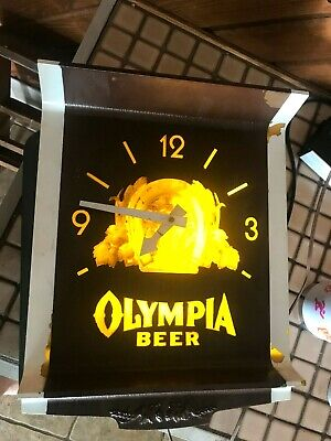 "VNTG OLYMPIA BEER METAL & PLASTIC (12"" x 13 1/2"" x 4"") WORKING LIGHTED CLOCK"