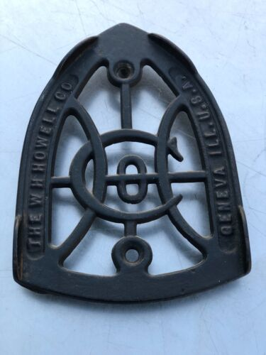 ANTIQUE  CAST IRON TRIVET THE W.H.HOWELL CO. GENEVA ILL. U.S.A. GREAT CONDITION