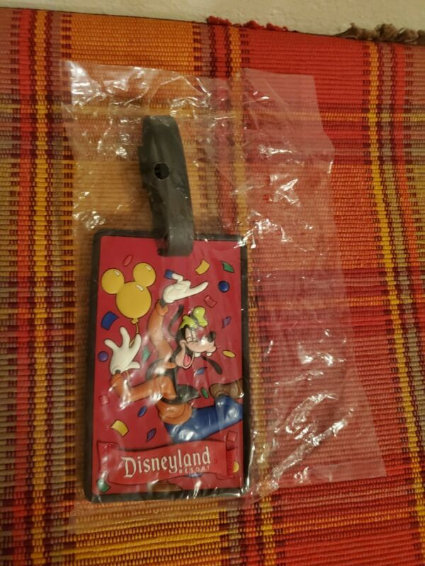Disneyland Resort  - Brand new in plastic  Luggage goofy tag