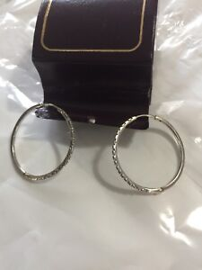 Large 10k white gold hoop earring with diamond