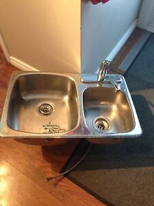 Kitchen sink with Moen faucet