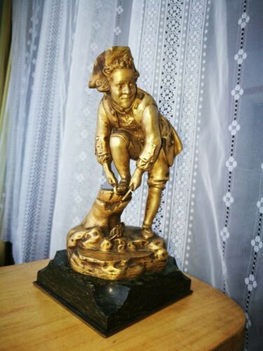 Superb bronze of a boy with skates