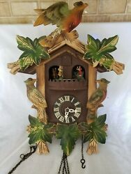 Antique wood cuckoo clock, birds, leaves