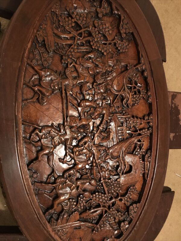 Chinese Oval Coffee Table with Hand-Carved Battle Scene and Six Stools