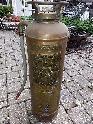 Empty Vintage Foamite riveted fire extinguisher