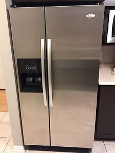 Side by side Whirlpool refrigerator in excellent condition