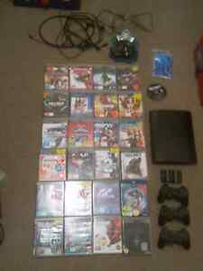 Ps3 slim500gb 25 games+ 3xcontrollers and extras Highland Park Gold Coast City Preview