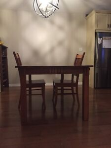 Dining table with two matching chairs