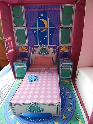 barbie doll case with dolls and clothes