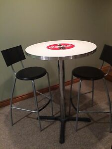 Round Coke bistro style table and 2 chairs