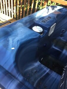 4 person hot tub, sold as is working last time used.