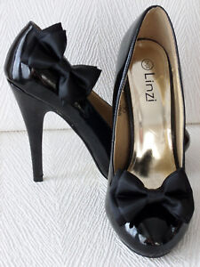 Pair of black double bow satin shoe clips