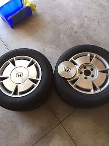 "Four 15"" alloy rims"