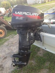 9.9 Mercury outboard two stroke engine with tank & line $1,200.