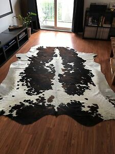 Large brindle/black, white cow hide rug