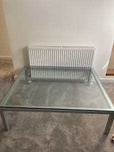 Glass coffee table with chrome stand