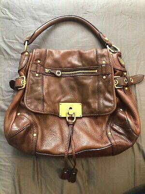 The Original Car Shoe By PRADA Brown Leather Tassel Locking Clasp Purse Handbag
