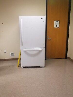 White LG refrigerator with bottom freezer and door handles