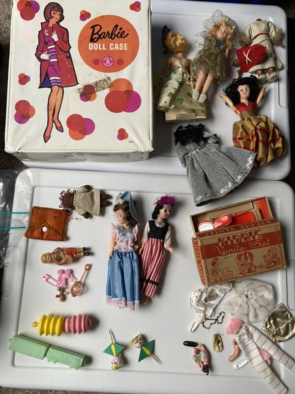 collection of dolls and accessories