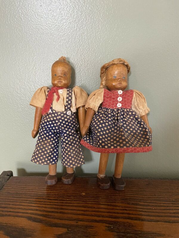 Antique Folk Art Carved Wooden Dolls with Hinged Limbs