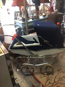 Assorted vintage baby buggy, bassinet and cradle