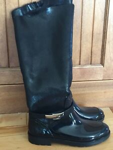Ladies size 7 High Black Boots- rubber bottom