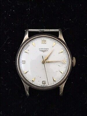 A 9ct Gold Longines Watch.
