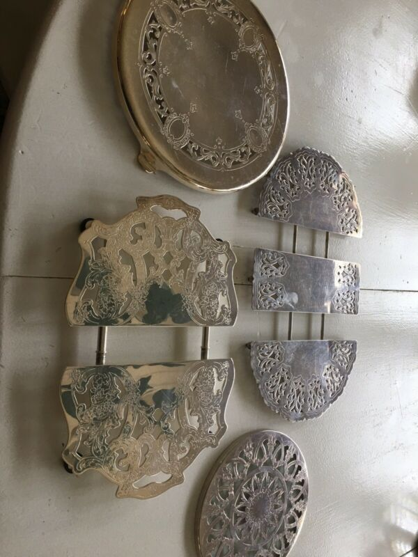 Four Silverplate Trivets One Glass Back