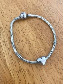 PANDORA silver bracelet and charm for sale