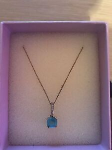 Micheal hill 10kt yellow white and gold pendant with blue topaz
