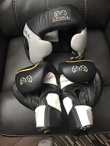 Rival boxing gloves and head gear
