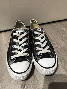 Leather Converse All Stars fits women's 6