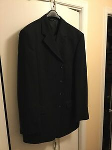 2 piece men's black suit - hardly worn fits 180lbs 6 foot person