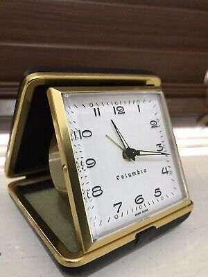Vintage travel alarm clock /columbia/wind up /folding/working nicely