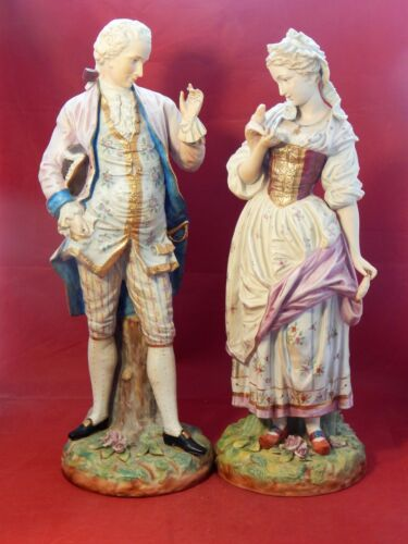 TWO COLORED BISQUE GERMAN FIGURINES,20 INCHES TALL. MAN & WOMAN PERIOD DRESS.