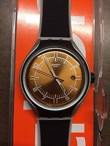 NEVER WORN Black and Orange Swatch for Men / Montre