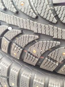 Set of studded winter tires on rims