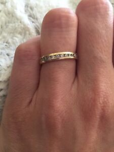 0.25 ct diamond channel band ring  in 14 k gold