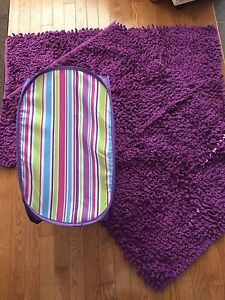 Purple rugs and hamper