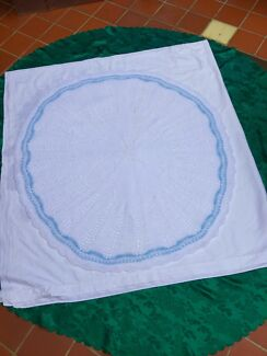 Hand knitted white with a blue trim bubbles baby shawl