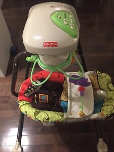 Fisher Price Automatic Swing with music and tray.