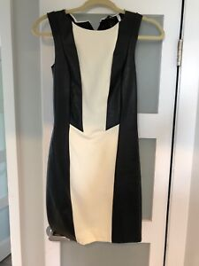 Dress with leather paneling