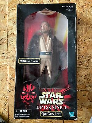Star Wars Episode 1 figure of Qui-Gon Jinn with lightsaber.