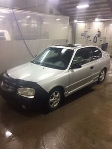 2001 Hyundai Accent for trade on a truck