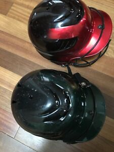 Two children's baseball helmets