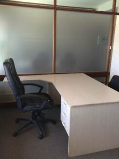 Office space with marked car space