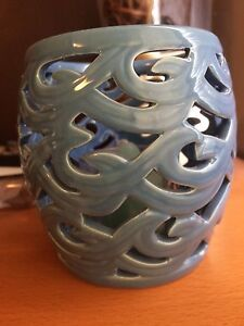 Blue candle holder with candle
