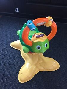 Child riding toy turtle