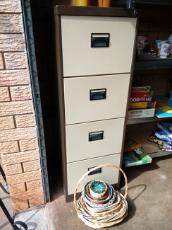 4 drawer filing cabinets. Good condition.