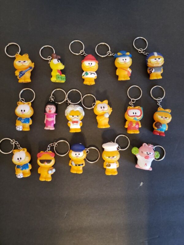 Lot Of 16 Vintage Paws Star Award Garfield Keychains